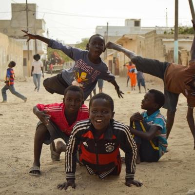 Talibe children play in the streets of dusty St. Louis in Senegal.